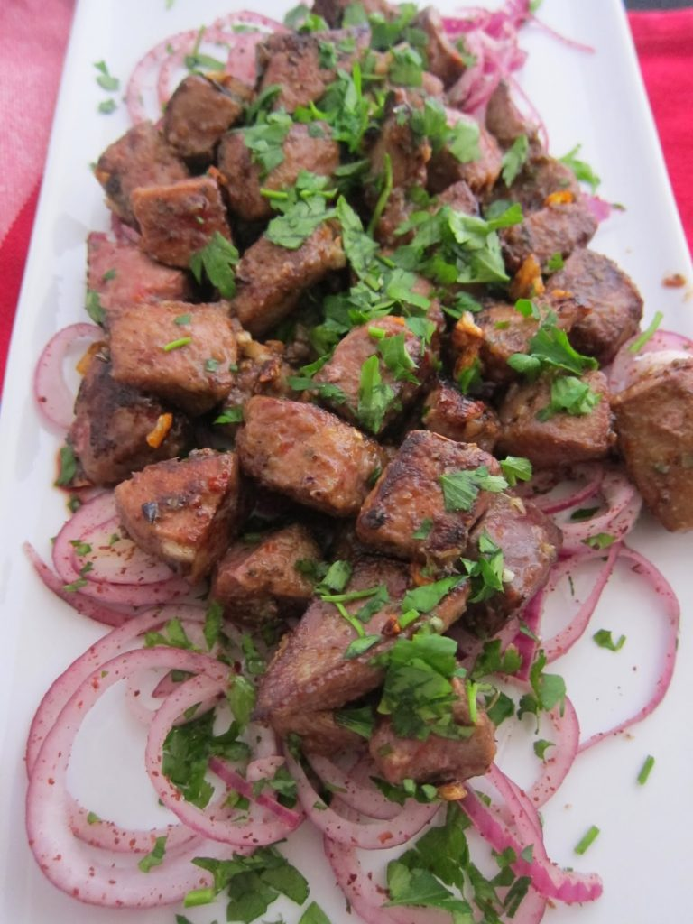 Liver on a bed of red onions