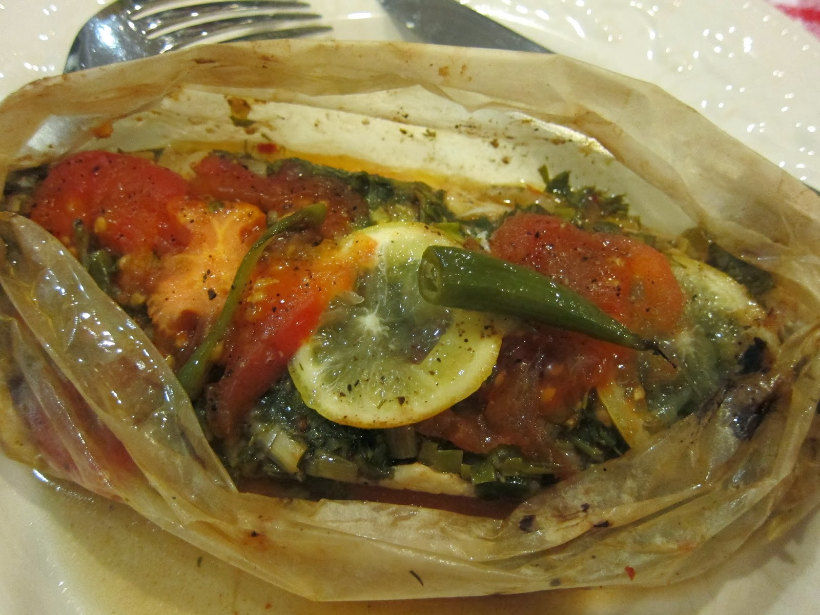 Sea bass baked in parchment with rak and herbs ka tta for Thanksgiving fish recipes