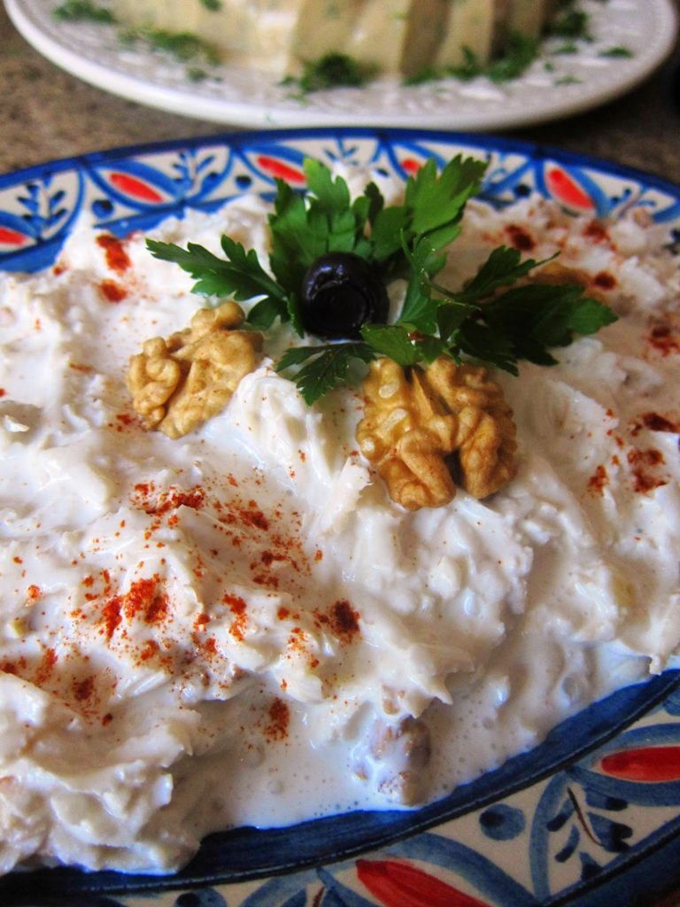 Celeriac with walnuts in garlic yogurt
