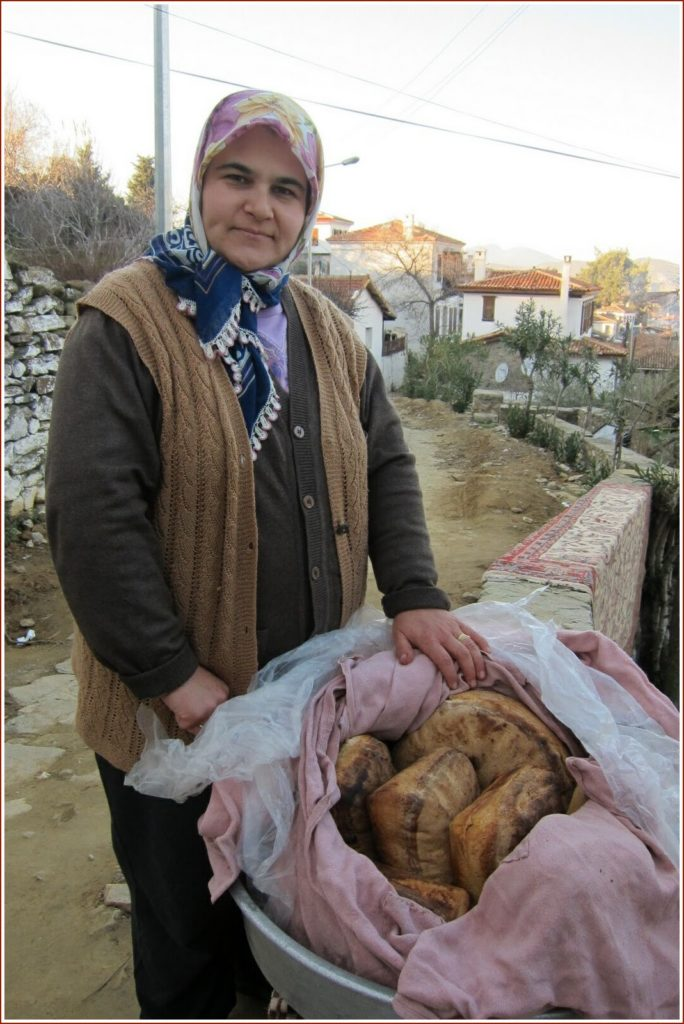 woman and her bread in Şirince